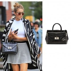 fb4a3d9dc781 Diane Von Furstenberg Bags - DVF's black leather 440 Gallery Secret Agent  tote